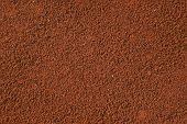 image of coffee grounds  - freshly ground roasted coffee backgrounds - JPG