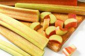 picture of cut  - detail of fresh cut rhubarb on wooden cutting board - JPG