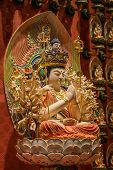 picture of gold tooth  - The Lord Buddha in Chinese Buddha Tooth Relic Temple in Chinatown of Singapore - JPG