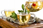 stock photo of teapot  - still life of the glass teapot flow green tea in cup on white background isolated tea ceremony - JPG