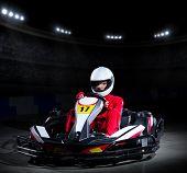 pic of karts  - Young girl karting racer at stadium - JPG