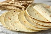 stock photo of whole-wheat  - Stack of homemade whole wheat flour tortilla on cutting board - JPG