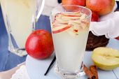 pic of cider apples  - Glass and carafe of apple cider with fruits and spices on table close up - JPG
