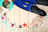 stock photo of flipper  - Sea composition with flippers and shells on wooden table close up - JPG