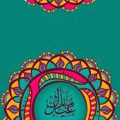 pic of eid mubarak  - Arabic calligraphy text Eid Mubarak on colorful floral design decorated green background for muslim community festival celebration - JPG