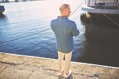 image of street-rod  - Man casting with light rod on the river near the dock - JPG