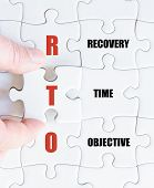 picture of objectives  - Hand of a business man completing the puzzle with the last missing piece - JPG