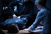 stock photo of interrogation  - Arrest of suspect man in interrogation room - JPG