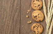 foto of chocolate-chip  - Cookies chocolate or chocolate chips on a wooden table - JPG