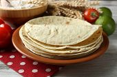 pic of whole-wheat  - Stack of homemade whole wheat flour tortilla and vegetables on plate - JPG