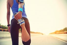 picture of japanese woman  - young fitness woman runner warm up outdoor - JPG