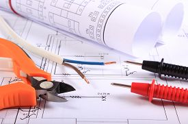 picture of electrical engineering  - Cables of multimeter metal pliers electric wire and construction drawings electrical drawings and tools for engineer jobs - JPG