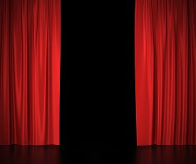stock photo of cinema auditorium  - Open red silk curtains for theater and cinema spotlit light in the center - JPG