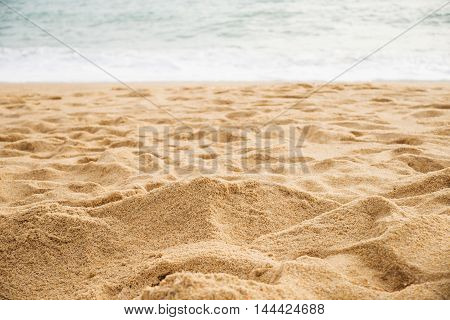 Sand on the beach of the sea with water of the sea Beach of the sea in nature White sand beach and blue sea blur background Sea with white sand beach in nature