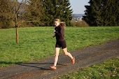 Young Woman Jogging Outdoors poster