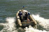 3 men in a rubber boat