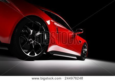 Modern Red Sports Car In A Spotlight On A Black Background