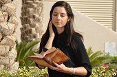 Young Beautiful Woman Reading