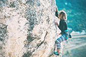 Girl Climbs The Rock. poster
