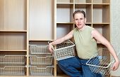 The man establishes baskets in a new wardrobe