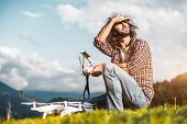 Bearded Curly Adult Hipster Man In Checkered Shirt Is Checking Out The Weather While Sitting Next To poster