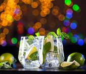 Closeup Of Mojito Cocktails On A Bar Lights Background. Ingredients And Utensils. poster