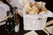 Elegant White Basket With Fresh Bread.