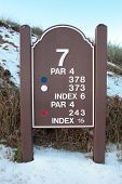 Seventh Tee Sign On A Snow Covered Links Golf Course