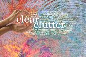 Clear The Chaotic Clutter From Your Life - Female Cupped Hands Around The Words Clear Clutter Surrou poster