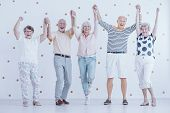 Smiling Elderly People Having Fun While Enjoying New Years Eve Party poster