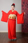Oriental Model Shows Sleeves On Japanese Kimono