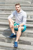 Working Out On Stairs. Man Athletic Appearance Holds Water Bottle. Man Athlete Sport Clothes Refresh poster