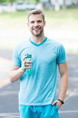 Drink Some Water. Man With Athletic Appearance Holds Water Bottle Man Athlete Sport Clothes Refreshi poster