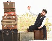 Man, Butler With Beard And Mustache Delivers Luggage, Luxury White Interior Background. Luggage And  poster