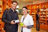 Happy Customer With Pharmacist