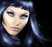 image of blue eyes  - Beauty Brunette Girl with Magic Hair - JPG