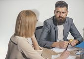 Bearded Man Sit At Desk With Woman, Back View. Businessman Work On Business Plan With Businesswoman. poster