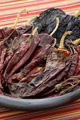 stock photo of chipotle chili  - delicious dried chili peppers great for mexican food and fusion cuisine - JPG