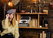 Girl In Casual Outfit With Kepi In Wooden Vintage Interior. Lady On Calm Face In Plaid Clothes Looks poster