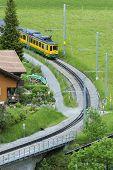 Train In Lauterbrunnen Valley, Swiss. Idyllic Landscape poster