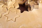advent cutting cookies stars