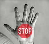 Men`s Palm With A Stop Sign. Red Hexagon And White Stop Sign.man Holds Palm In Front Of Him. He Has  poster