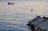 The Fisherman Is Fishing While Sundown In Marmara Sea, Turkey. poster