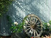 Old Wagon Wheel In Evening Light poster