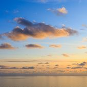 Bright Cumulus Clouds Against The Blue Sky. Sunset Sky Natural Background. Seascape poster