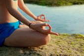 Lotus Yoga Pose. Close Up Gyan Mudra. Focus On One Hand. Yoga At The Beach. Young Woman Sitting On S poster