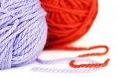 Balls Of Purple And Orange Yarn Or Wool