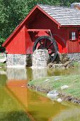 A Red Grist Mill by a Stream
