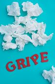 a pile of used tissues and the word gripe, flu written in spanish, on a blue background poster