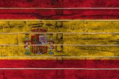 National Flag  Of Spain On A Wooden Wall Background. The Concept Of National Pride And A Symbol Of T poster